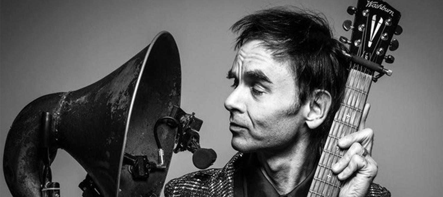head shot of man with instruments, black and white image