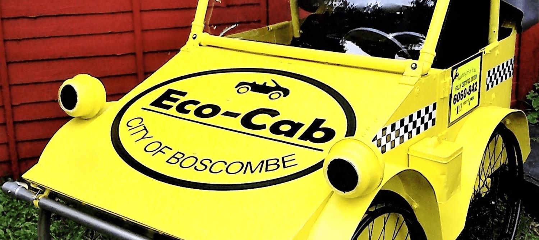 Small yellow 'Eco- Cab' car.