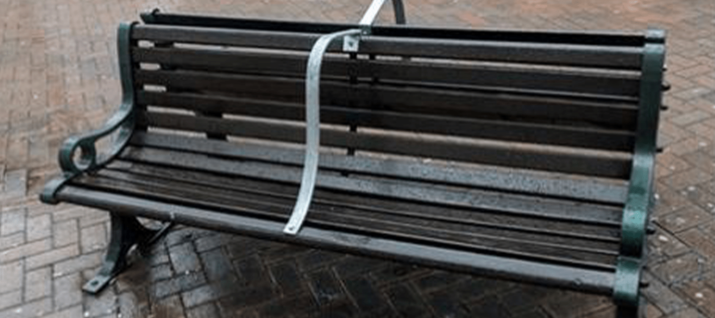 Bench with hostile design bars on it.