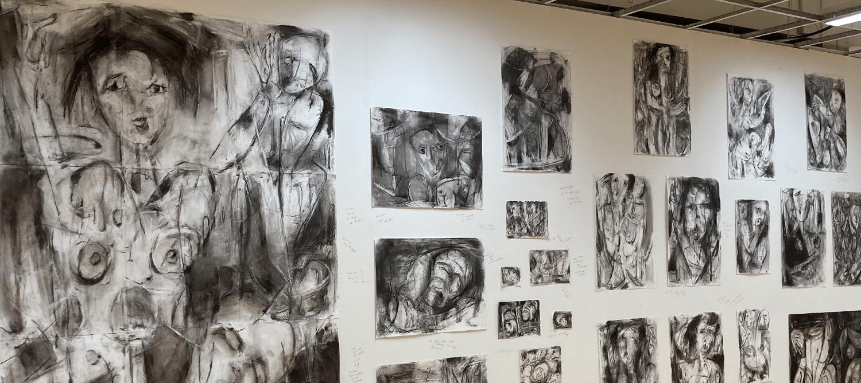 A selection of Ineke Van De Wal's drawings afixed to a white wall