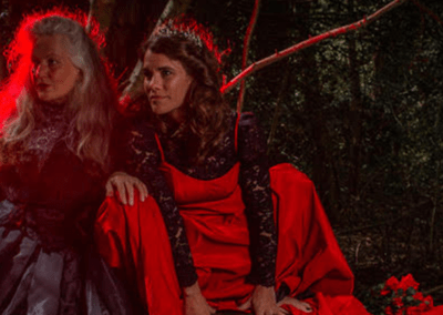 Two women under a trees under a red light