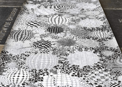 Large black and white geometric drawing on the floor.