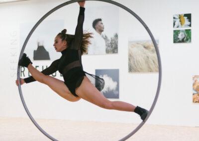 Woman in black performing on a Rhönrad wheel