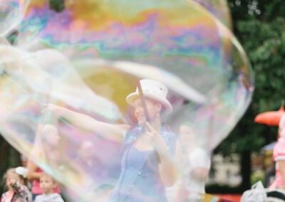 Performer at Churchill Gardens photographed with large bubble in the foreground