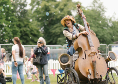Female performer playing the cello in Churchill Gardens